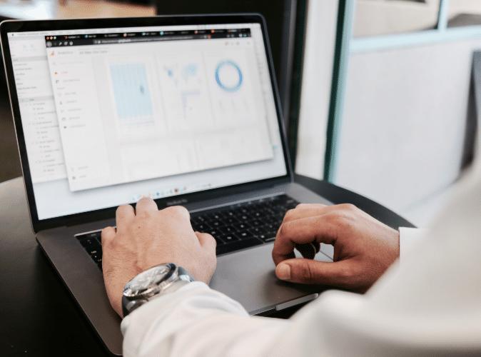businessman using macbook