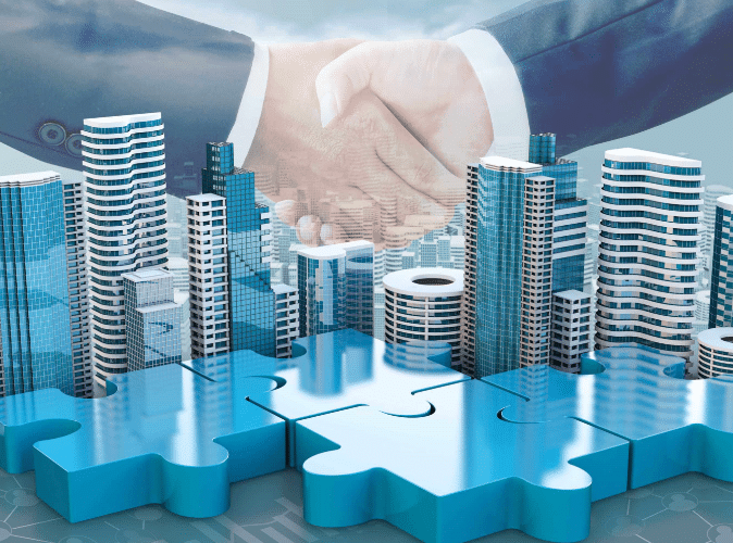 two hands shaking with skyscrapers overlay