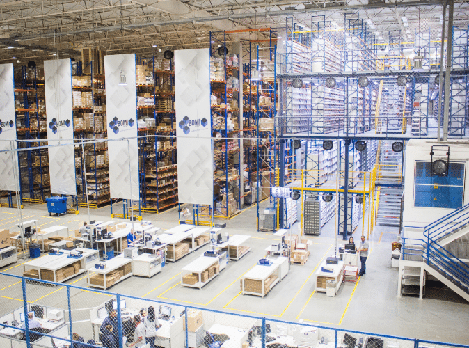 Large warehouse with workers