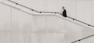 businessman walking up outdoor stairs